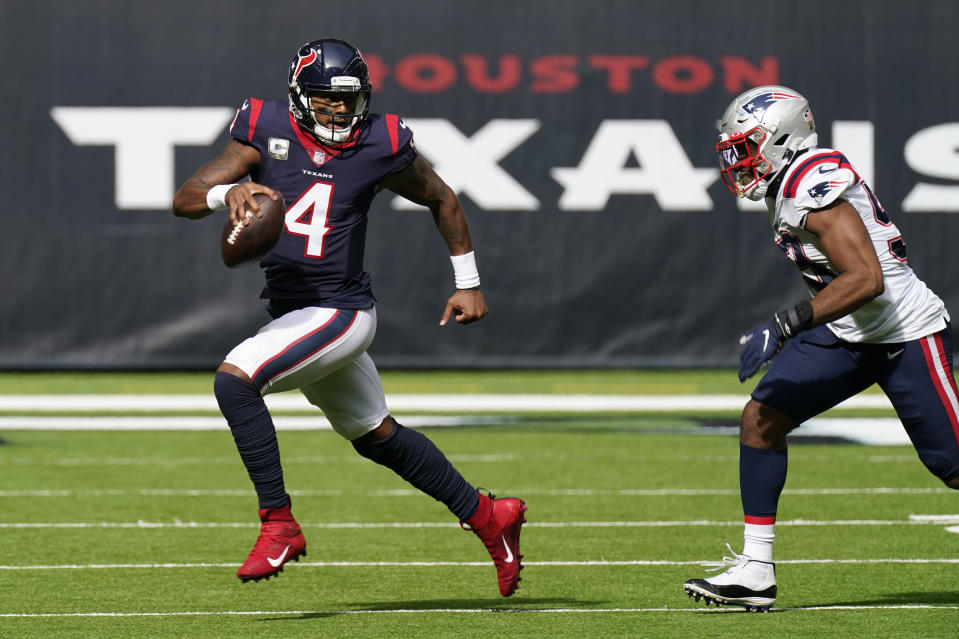 Houston Texans quarterback Deshaun Watson (4) runs past New England Patriots linebacker Josh Uche (53) during the first half of an NFL football game, Sunday, Nov. 22, 2020, in Houston. (AP Photo/David J. Phillip)