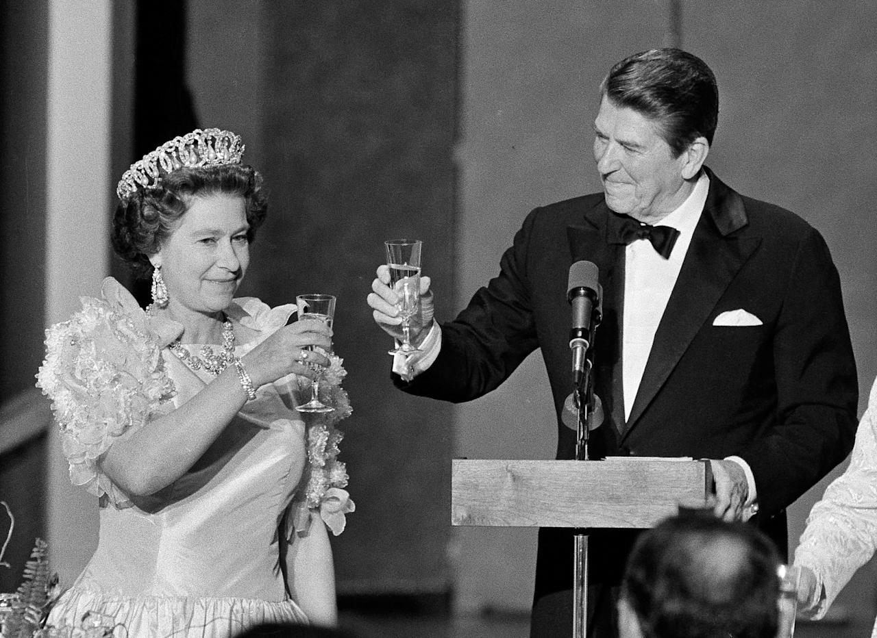 FILE - In this March 3, 1983 photo by Associated Press photographer Ed Reinke, President Ronald Reagan and Queen Elizabeth II raise their glasses in a toast during a state dinner at the M. H. de Young Museum in San Francisco's Golden Gate Park. Ed Reinke, an award-winning AP photographer who traveled worldwide and was known for his striking pictures of Kentucky news and sporting events, died Tuesday, Oct. 18, 2011 following an injury, according to his family. He was 60. (AP Photo/Ed Reinke, File)