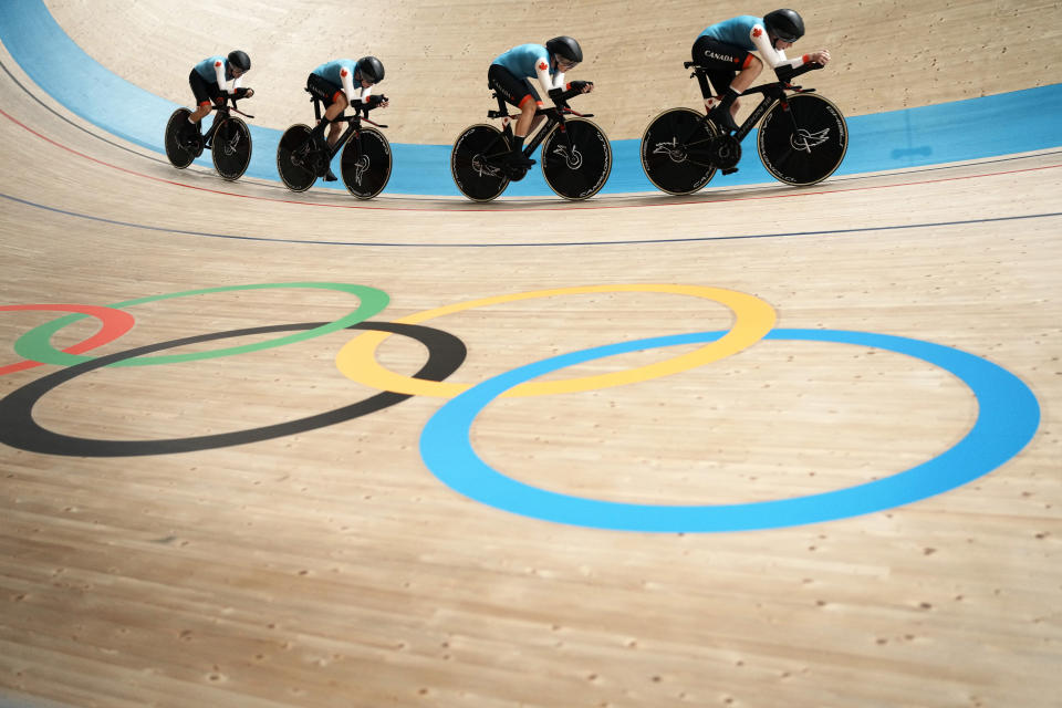 Team Canada competes during the track cycling women's team pursuit at the 2020 Summer Olympics, Monday, Aug. 2, 2021, in Izu, Japan. (AP Photo/Thibault Camus)