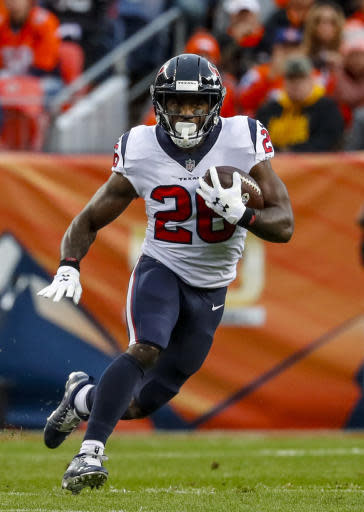 FILE - In this Nov. 4, 2018, file photo, Houston Texans running back Lamar Miller runs against the Denver Broncos during the first half of an NFL football game, in Denver. Lamar Miller was searching for ways to improve this off-season after what he calls a disappointing 2017 campaign. It was then that the Texans running back decided to take the advice of two former Miami Hurricane running backs with a combined 25 years of NFL experience. AP Photo/Jack Dempsey, File)