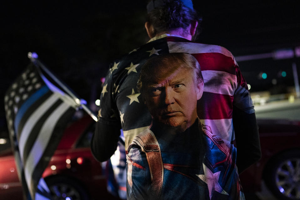 WASHINGTON, DC - OCTOBER 3: Supporters of U.S. President Donald Trump rally outside Walter Reed National Military Medical Center on October 3, 2020 in Bethesda, Maryland. Trump arrived at the hospital yesterday after testing positive for COVID-19. (Photo by Alex Edelman/Getty Images)