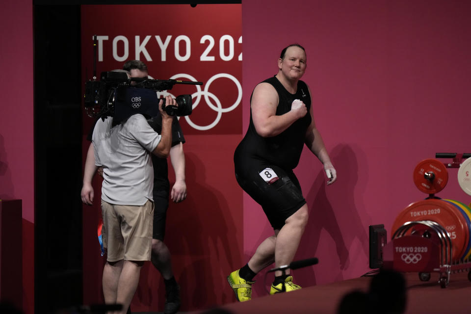 Laurel Hubbard of New Zealand walks on to the podium to compete in the women's +87kg weightlifting event at the 2020 Summer Olympics, Monday, Aug. 2, 2021, in Tokyo, Japan. (AP Photo/Luca Bruno)