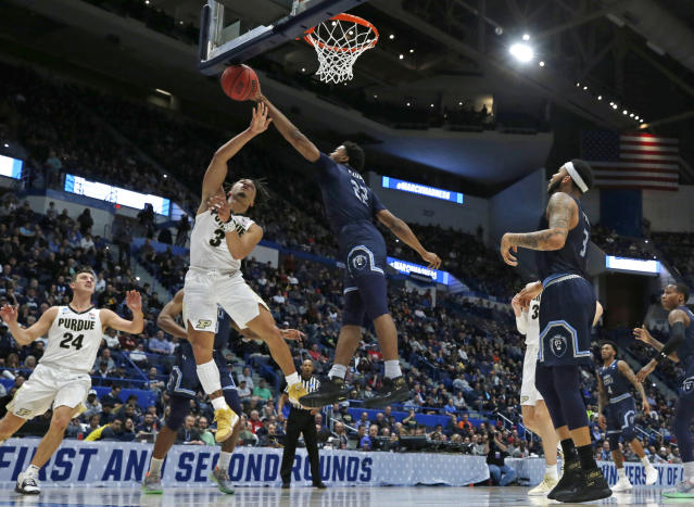 Old Dominion's Kalu Ezikpe (22) blocks a shot by Purdue's Carsen Edwards (3) as Purdue's Grady Eifert (24) and Old Dominion's B.J. Stith (3) look on during the first half of a first-round game in the NCAA mens college basketball tournament Thursday, March 21, 2019, in Hartford, Conn. (AP Photo/Elise Amendola)