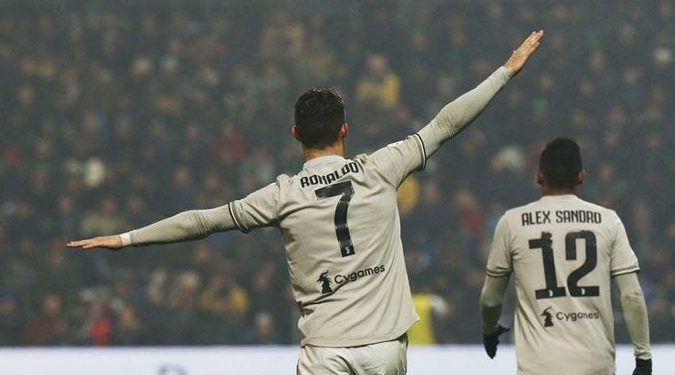 Juventus' Cristiano Ronaldo celebrates after scoring his side's second goal during series soccer match between Sassuolo and Juventus, at the Mapei Stadium in Reggio Emilia, Italy