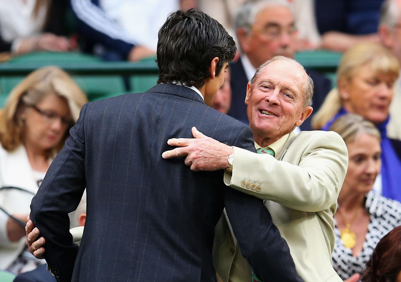 LONDON, ENGLAND - JUNE 28: (L-R) England cricket captain Alastair Cook is hugged by Geoffrey Boycott as he takes his seat in the Royal Box on Centre Court on day five of the Wimbledon Lawn Tennis Championships at the All England Lawn Tennis and Croquet Club on June 28, 2013 in London, England. (Photo by Julian Finney/Getty Images)