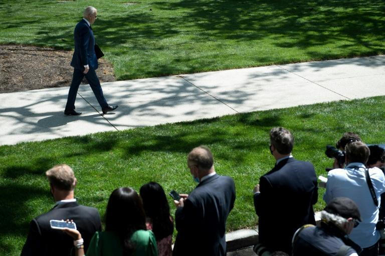US President Joe Biden leaves after speaking about updated CDC guidance on masks