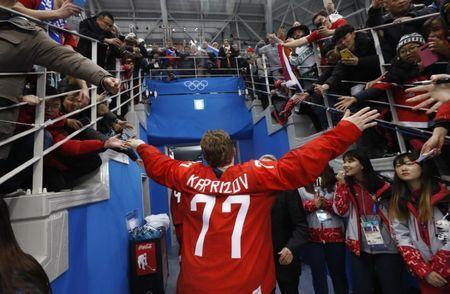 Ice Hockey - Pyeongchang 2018 Winter Olympics - Men's Final Match - Russia - Germany - Gangneung Hockey Centre, Gangneung, South Korea - February 25, 2018 - Olympic Athlete from Russia Kirill Kaprizov reacts with supporters after Russia won. REUTERS/Kim Kyung-Hoon
