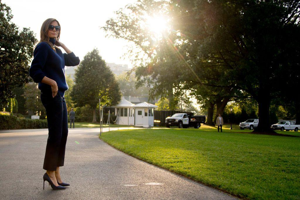 <p>Before boarding Marine One to Puerto Rico to view the damage from Hurricane Maria, Melania was spotted wearing navy blue stilettos. Before landing, she changed into work boots. </p>