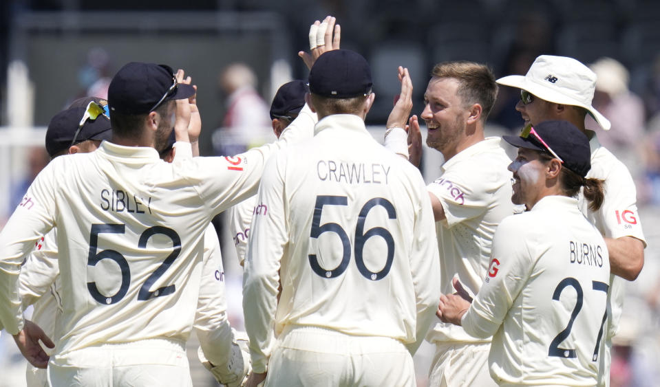 England's Ollie Robinson celebrates taking the wicket of New Zealand's Colin de Grandhomme during the second day of the Test match between England and New Zealand at Lord's cricket ground in London, Thursday, June 3, 2021. (AP Photo/Kirsty Wigglesworth)