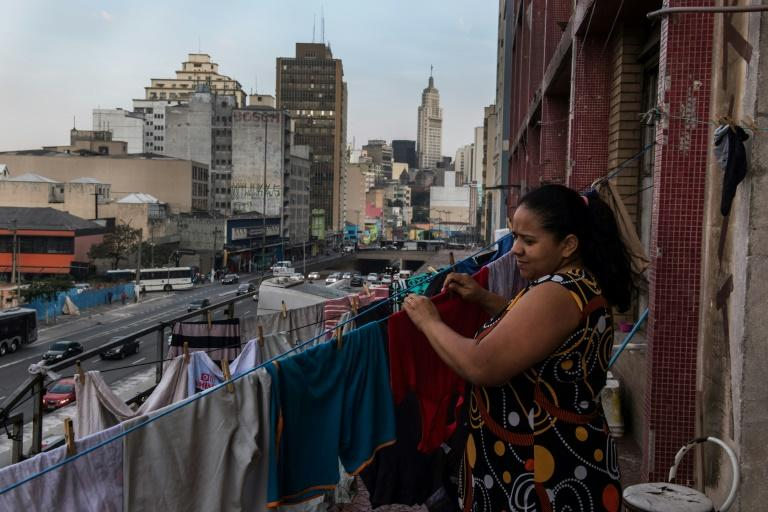 A squatter resident at her building in Sao Paulo, one of about 200 that illegally house 46,000 families, a reflection of a severe housing shortage in the Brazilian city