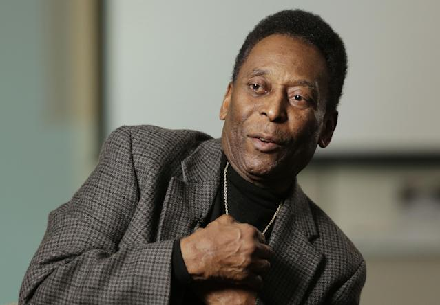 In this Wednesday, April 2, 2014 photo, Edson Arantes do Nascimento, better known as Pele, is interviewed at The Associated Press in New York. In a little more than two months, the World Cup will be played in Brazil for the first time since 1950, when 9-year-old Edson's father listened on the radio as Brazil lost the final round-robin game and the title 2-1 to Uruguay in Rio de Janeiro. (AP Photo/Mark Lennihan)