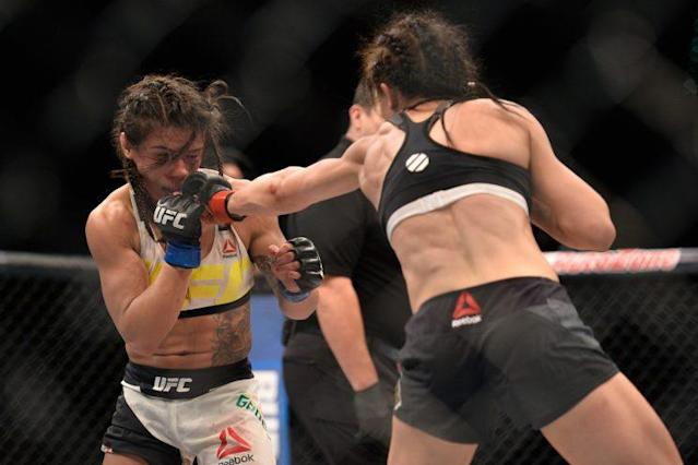 Joanna Jędrzejczyk (R) lands a jab on Claudia Gadelha during their bout in July. (Getty Images)