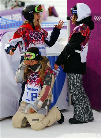 Winner Jamie Anderson of the U.S. (bottom), third-placed Britain's Jenny Jones and second-placed Finland's Enni Rukajarvi (R) celebrate after the women's snowboard slopestyle competition at the 2014 Sochi Olympic Games in Rosa Khutor February 9, 2014. REUTERS/Mike Blake