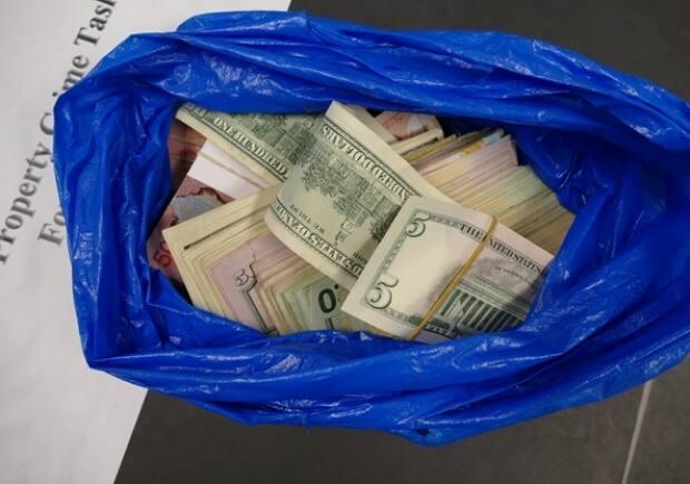 Police say this cash was seized as part of the investigation. (York Regional Police - image credit)