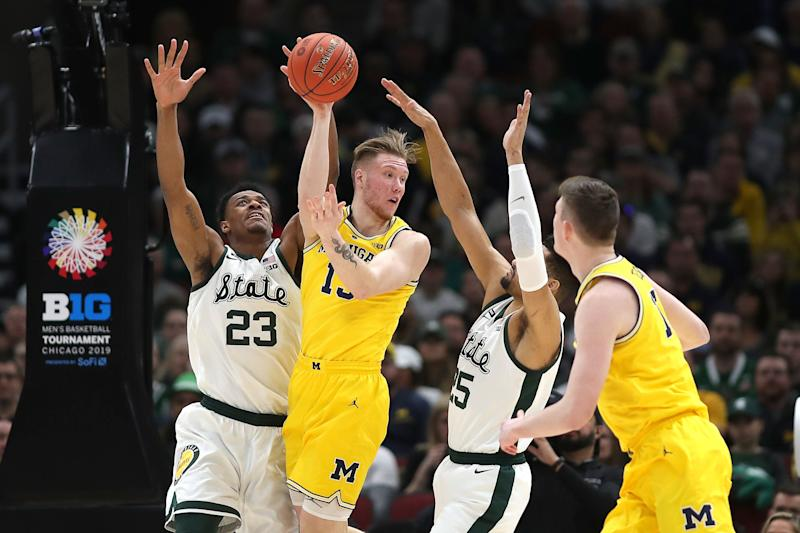 CHICAGO, IL - MARCH 17: Michigan Wolverines forward Ignas Brazdeikis (13) battles with Michigan State Spartans forward Xavier Tillman (23) and Michigan State Spartans forward Kenny Goins (25) during a Big Ten Tournament Championship game between the Michigan Wolverines and the Michigan State Spartans on March 17, 2019, at the United Center in Chicago, IL. (Photo by Robin Alam/Icon Sportswire via Getty Images)