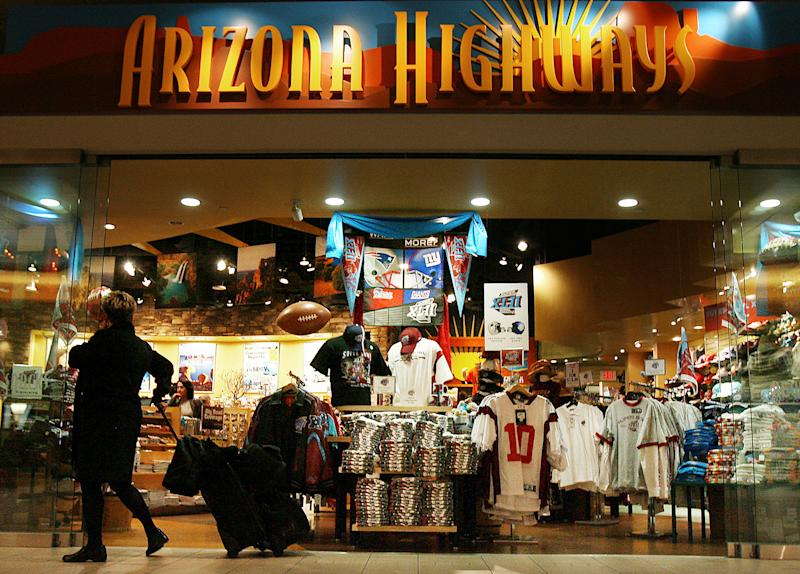 In this Jan. 29, 2008 file photo, Super Bowl merchandise is on full display in the Arizona Highways retail store at Phoenix Sky Harbor International Airport in Phoenix. Visitors spend money at NFL-funded events and buy NFL-branded memorabilia during Super Bowl week instead of frequenting local establishments, according to Philip Porter, an economics professor at the University of South Florida. (AP Photo/Ross D. Franklin, File)