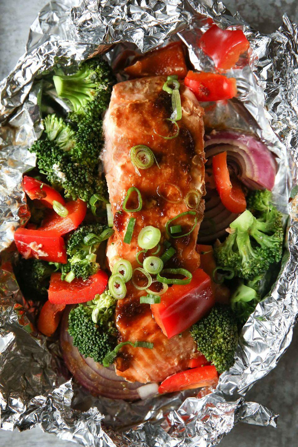"<p>*no clean-up required.</p><p>Get the <a href=""https://www.delish.com/uk/cooking/recipes/a29840607/salmon-foil-packs-recipe/"" rel=""nofollow noopener"" target=""_blank"" data-ylk=""slk:Salmon Foil Packs"" class=""link rapid-noclick-resp"">Salmon Foil Packs</a> recipe. </p>"