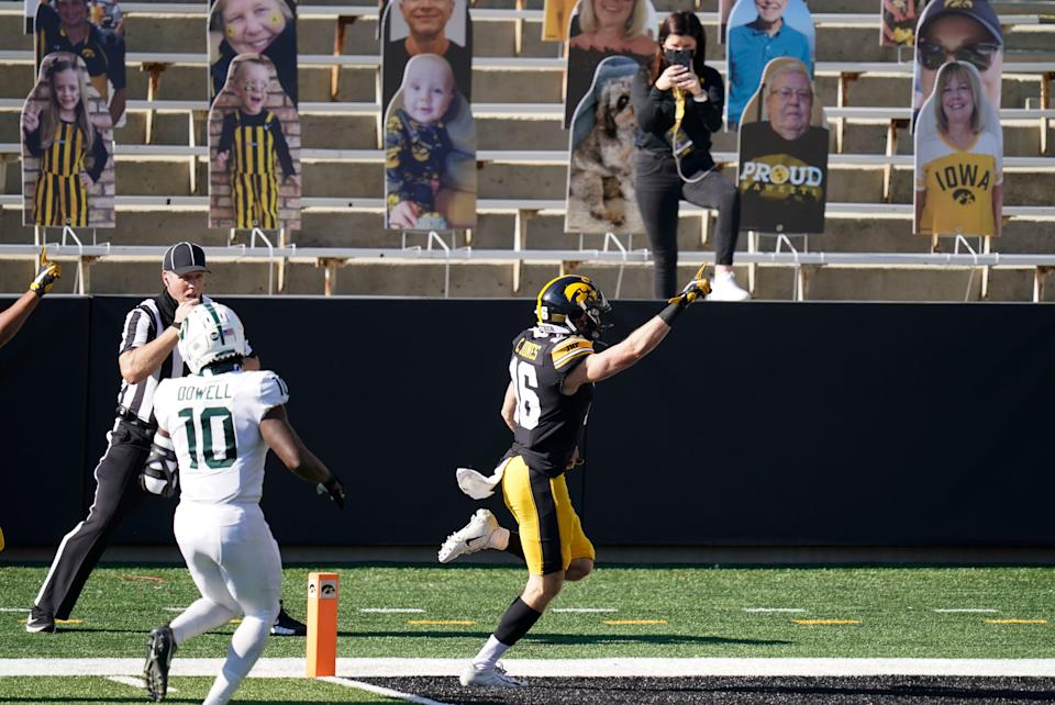Iowa's Charlie Jones (16) scores a touchdown on a 54-yard punt return ahead of Michigan State's Michael Dowell (10) during the first half of an NCAA college football game, Saturday, Nov. 7, 2020, in Iowa City, Iowa.