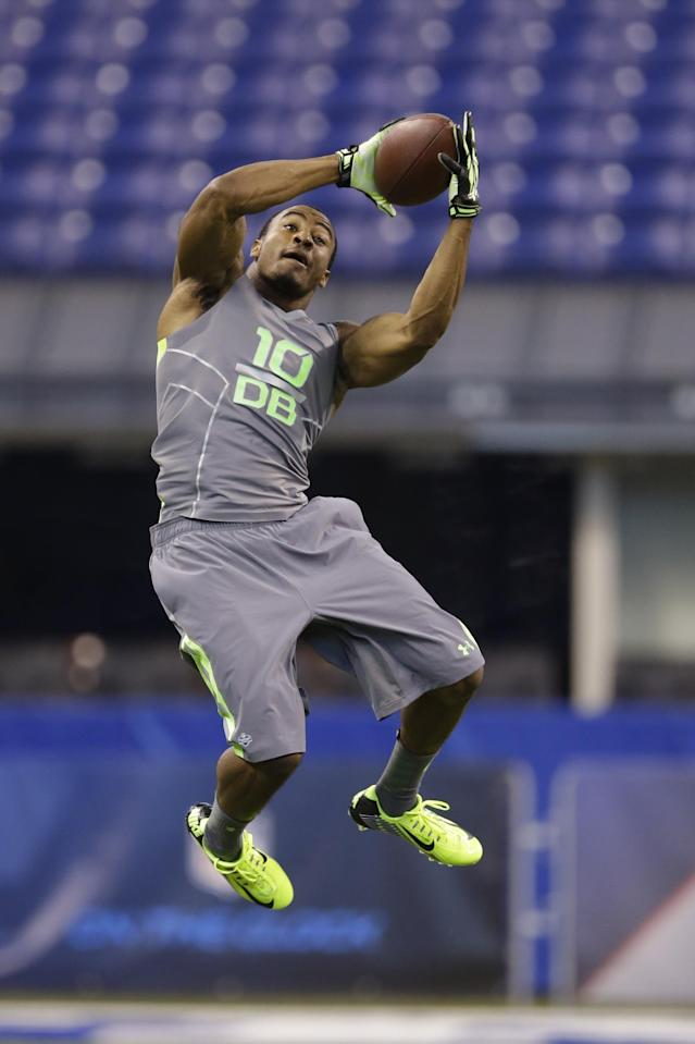 Washington State defensive back Deone Bucannon runs a drill at the NFL football scouting combine in Indianapolis, Tuesday, Feb. 25, 2014. (AP Photo/Michael Conroy)