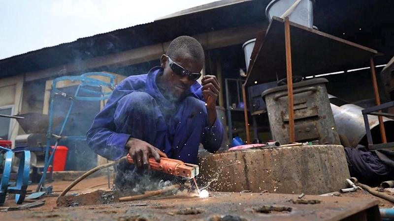A Finic engineer builds a machine part in Sierra Leone