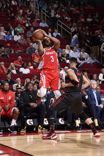 HOUSTON, TX - APRIL 5: Chris Paul #3 of the Houston Rockets shoots the ball against the Portland Trail Blazers on April 5, 2018 at the Toyota Center in Houston, Texas. (Photo by Bill Baptist/NBAE via Getty Images)