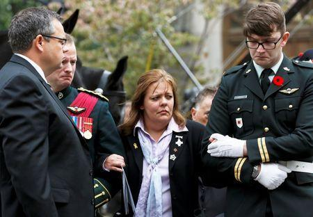 Kathy Cirillo is comforted after leaving the church following the funeral service for her son, Cpl. Nathan Cirillo in Hamilton, Ontario October 28, 2014. REUTERS/Chris Wattie
