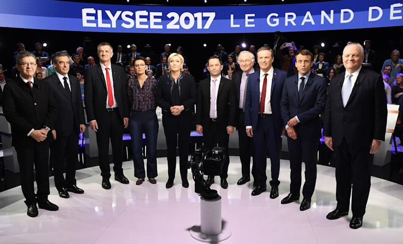 Candidates pose prior to a prime-time televised debate for the French 2017 presidential election .