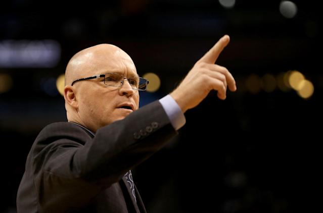 ORLANDO, FL - JANUARY 22: Scott Skiles of the Orlando Magic points during the game against the Charlotte Hornets at Amway Center on January 22, 2016 in Orlando, Florida. NOTE TO USER: User expressly acknowledges and agrees that, by downloading and/or using this Photograph, user is consenting to the terms and conditions of the Getty Images License Agreement. (Photo by Sam Greenwood/Getty Images)
