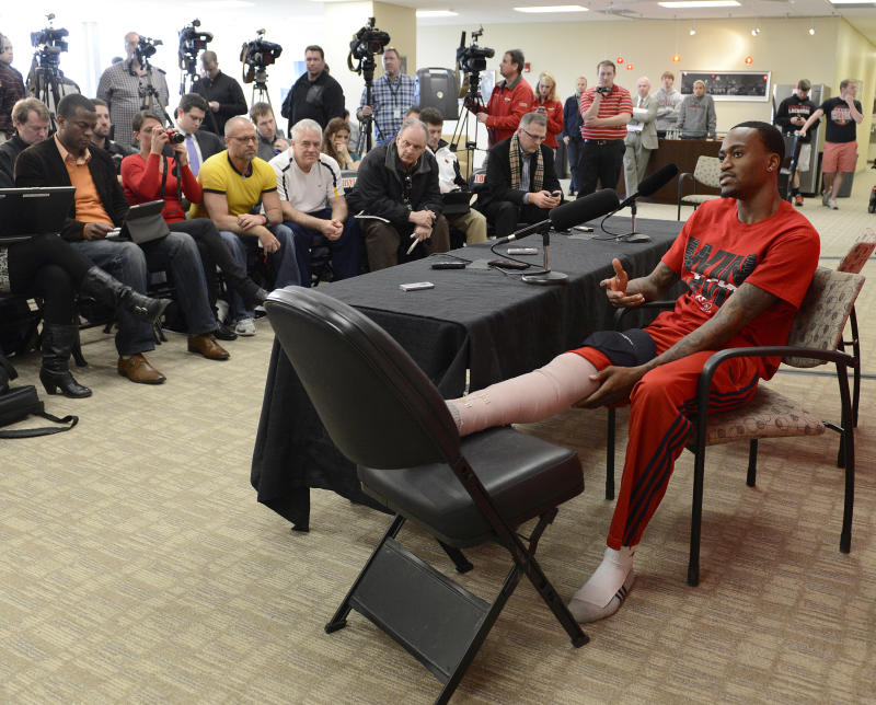 Louisville basketball player Kevin Ware answers questions during a press conference, Wednesday April 3, 2013, at the KFC Yum! Center practice facility in Louisville, Ky. Ware was released from an Indianapolis hospital Tuesday, two days after millions watched him break his right leg on a horrifying play trying to block a shot during an NCAA college basketball regional championship game against Duke.  (AP Photo/Timothy D. Easley)