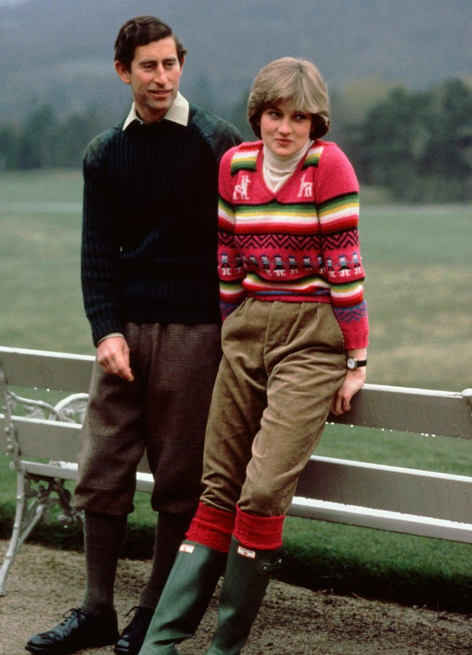 <p>Ahead of their royal wedding, Princess Diana posed for a photo with Prince Charles at Balmoral wearing a pink patterned pullover with trousers and boots.</p>