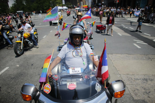 <p>A reveler rides a motorcycle in the annual Pride Parade on June 24, 2018 in New York City. (Photo: Kena Betancur/Getty Images) </p>