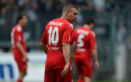 Cologne's Lukas Podolski, seen here during their German first division Bundesliga match against Borussia 'Gladbach in the German city of Moenchengladbach, on April 15. Arsenal-bound Podolski is hoping to be fit to help Cologne in their battle to stay in the German league against his former club Bayern Munich on Saturday on the last weekend of the Bundesliga