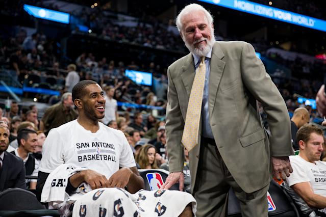 "<a class=""link rapid-noclick-resp"" href=""/nba/players/4130/"" data-ylk=""slk:LaMarcus Aldridge"">LaMarcus Aldridge</a> and Gregg Popovich get on the same page. (AP)"