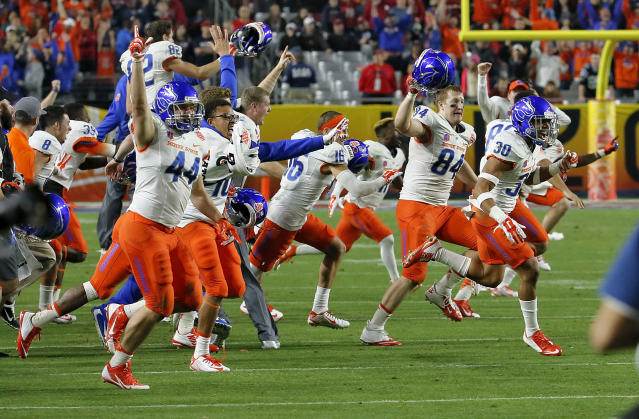 Boise State players run on the field as time expires in the Fiesta Bowl NCAA college football game against Arizona, Wednesday, Dec. 31, 2014, in Glendale, Ariz. Boise State won 38-30. (AP Photo/Matt York)