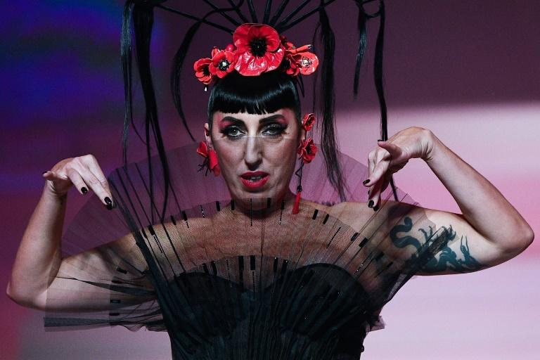 Spanish actress Rossy de Palma was among the collection of friends and stars who joined the show (AFP Photo/Anne-Christine POUJOULAT)