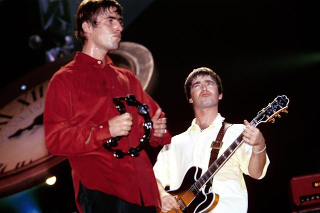 Liam Gallagher and Noel Gallagher performing live onstage (Photo by Simon Ritter/Redferns)