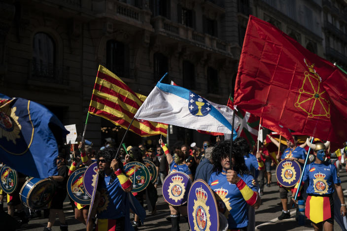 Members and supporters of National Police and Guardia Civil march during a protest demanding better pay in Barcelona, Spain, Saturday, Sept. 29, 2018. (AP Photo/Felipe Dana)