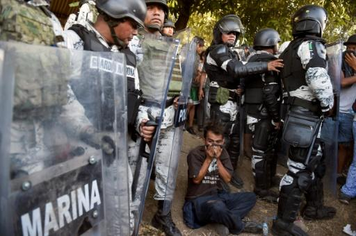 Central American migrants are blocked by members of the Mexican National Guard in Chiapas State on January 23