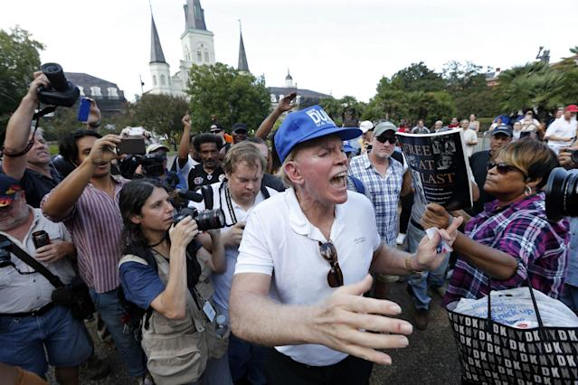 <p>Former Ku Klux Klan leader and current Senate candidate David Duke tries to speak as he is taunted by hecklers, prior to a protest organized by Take 'Em Down NOLA, Sept. 24, 2016. (Photo: Gerald Herbert/AP) </p>