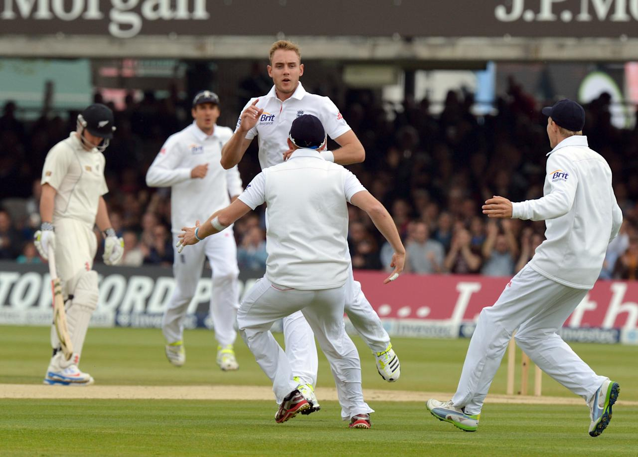 England's Stuart Broad celebrates taking the wicket of New Zealand's Peter Fulton for 1 during the first test at Lord's Cricket Ground, London.