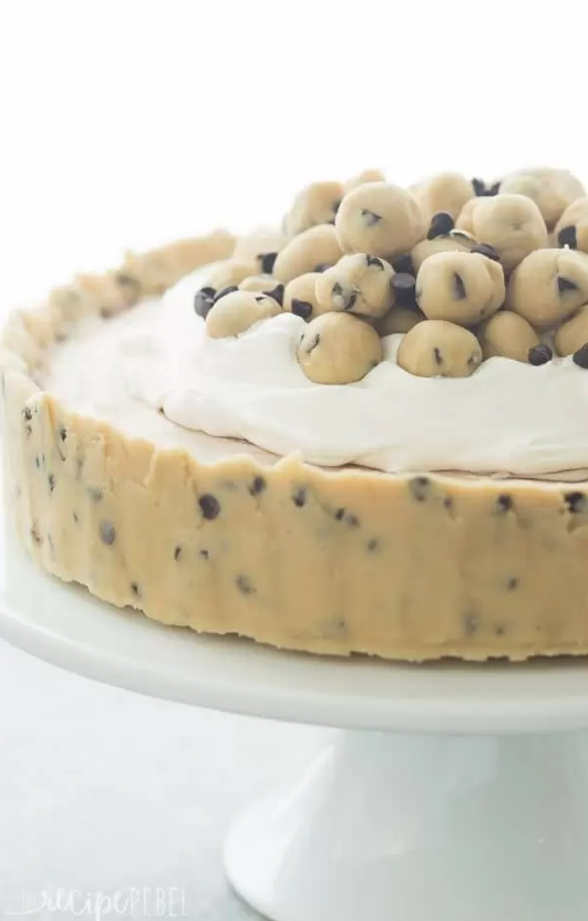 """<p>For added convenience, go the no-bake route with your dessert contribution. This frozen cookie dough creation easily rivals store-bought versions. </p><p><strong>Get the recipe at <a href=""""https://www.thereciperebel.com/no-bake-cookie-dough-ice-cream-cake-recipe-video/"""" rel=""""nofollow noopener"""" target=""""_blank"""" data-ylk=""""slk:The Recipe Rebel"""" class=""""link rapid-noclick-resp"""">The Recipe Rebel</a>. </strong> </p>"""