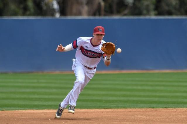"""LMU's Nick Sogard LMU goes for a catch against Saint Mary's on May 20, 2018. <span class=""""copyright"""">(LMU Athletics)</span>"""