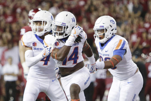 "Boise State cornerback <a class=""link rapid-noclick-resp"" href=""/ncaaf/players/251423/"" data-ylk=""slk:Tyler Horton"">Tyler Horton</a> (14) got to sit on the turnover throne in Week 1. (AP Photo/Young Kwak)"
