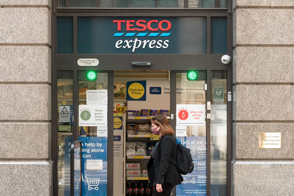 A woman wearing a mask walks past a Tesco Express store in London. In recent weeks, the number of confirmed covid cases in the UK has been on the rise, and has reached the highest ever since the re-opening of economic activities. Among the surge is the emergence of a new variant of the COVID 19 virus, known as Indian variant or Delta variant. While people are dining out and engaging in everyday activities as if COVID is over, restaurants and members of the police are still seen to be maintaining social distancing measures to mitigate the latest surge caused by increased contact as the city picks up in speed. (Photo by Belinda Jiao / SOPA Images/Sipa USA)