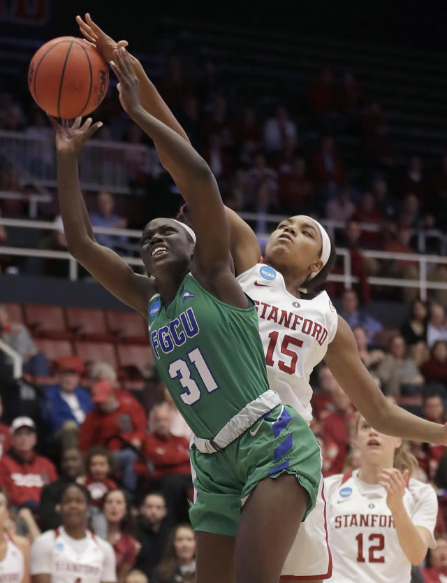 Stanford forward Maya Dodson (15) blocks a shot by Florida Gulf Coast forward Nasrin Ulel (31) during the first half of a second-round game in the NCAA women's college basketball tournament in Stanford, Calif., Monday, March 19, 2018. (AP Photo/Jeff Chiu)