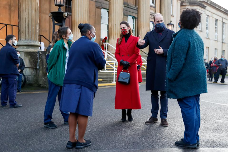 READING, UNITED KINGDOM - DECEMBER 08: Prince William, Duke of Cambridge and Catherine, Duchess of Cambridge meet NHS staff at Royal Berkshire Hospital on December 8, 2020 in Reading, England. The royal couple paid tribute to the efforts of staff throughout the COVID-19 pandemic, during the final day of engagements on their tour of the UK. During their trip, their Royal Highnesses have paid tribute to individuals, organisations and initiatives across the country that have gone above and beyond to support their local communities this year. (Photo by Matthew Childs - WPA Pool/Getty Images)