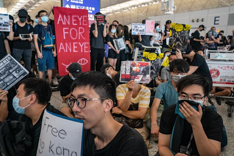 Protesters occupy the departure hall of the Hong Kong International Airport during a demonstration on August 12, 2019.