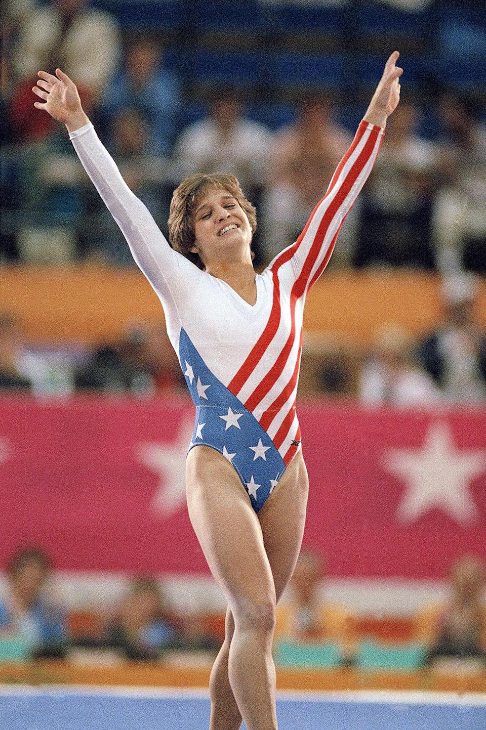 <p>Mary Lou Retton celebrates her gold medal win at the 1984 Olympic Games in Los Angeles. (AP Photo/Lionel Cironneau, File) </p>