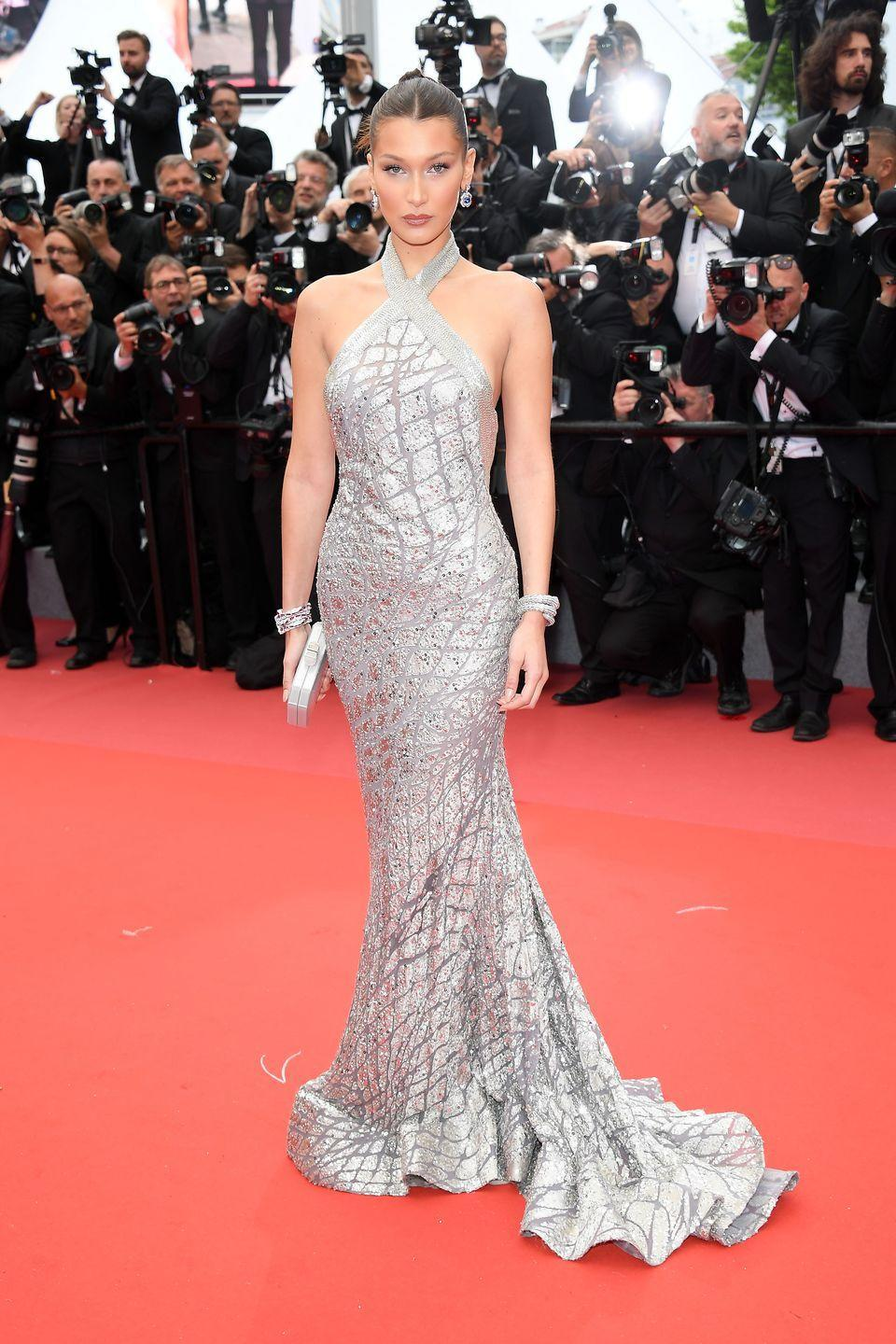 <p>The 21-year-old rocked a sleek silver sequined column gown for the premiere of Blackkklansman at the Cannes Film Festival in May 2018. She wore her hair in a bun and accessorised with giant sapphire dangle earrings. </p>