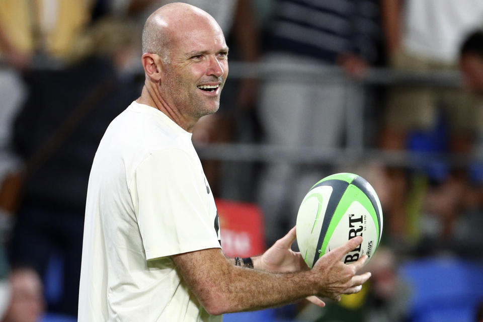 South Africa's head coach Jacques Nienaber catches a ball as his team warms up ahead of their Rugby Championship match against Australia on Sunday, Sept. 12, 2021, Gold Coast, Australia. (AP Photo/Tertius Pickard)